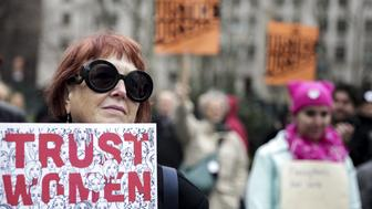 A demonstrator holds a sign that reads 'Trust Women' during The People's Filibuster rally at Foley Square in New York, U.S., on Saturday, April 1, 2017. The People's Filibuster is a nation wide rally in objection to U.S. President Donald Trump's agenda and his appointment of Judge Neil Gorsuch to the Supreme Court. Photographer: Jeenah Moon/Bloomberg via Getty Images