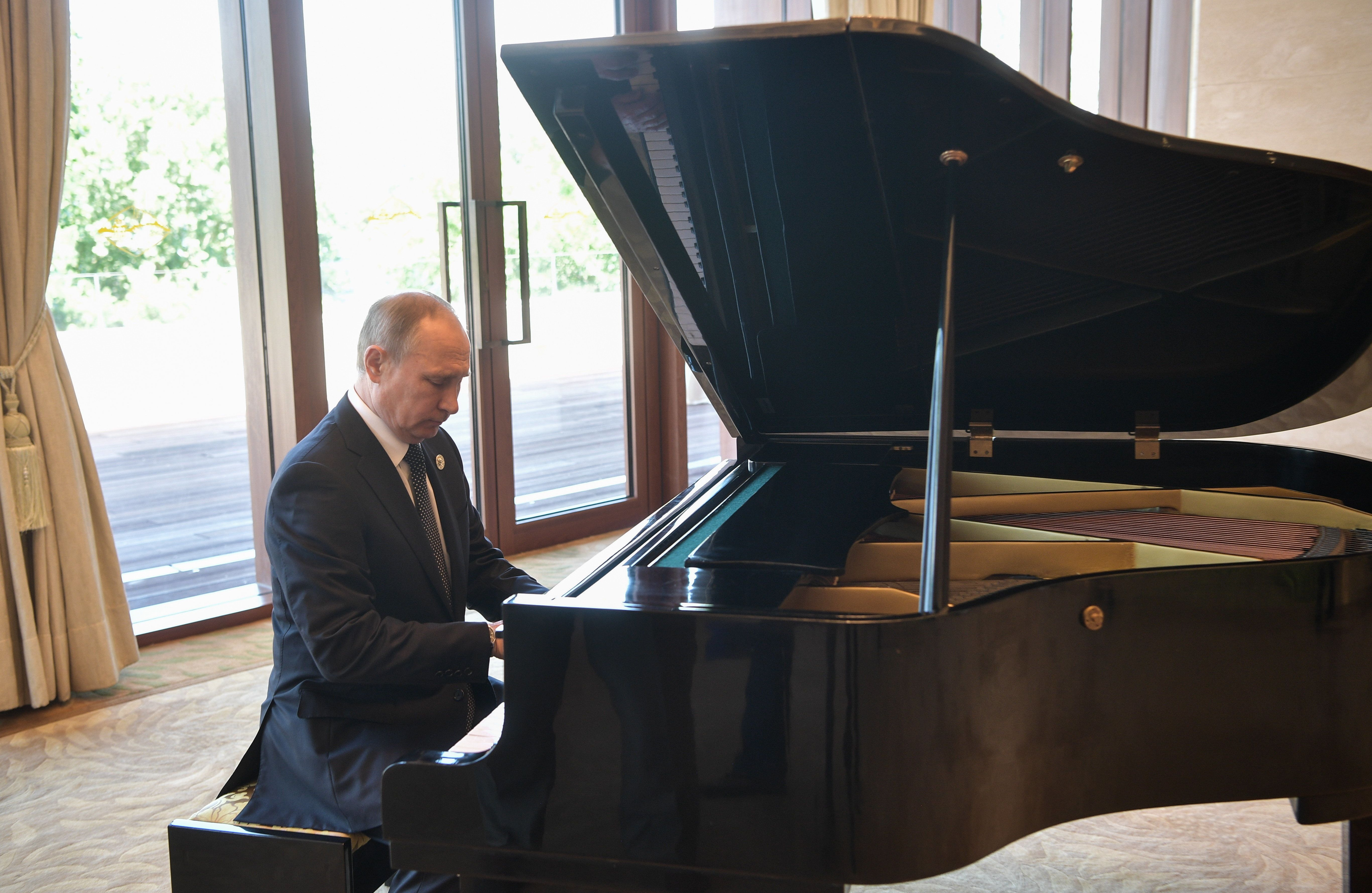 BEIJING, CHINA - MAY 14, 2017: Russias President Vladimir Putin plays the grand piano ahead of a meeting with China's President Xi Jinping at the Diaoyutai State Guesthouse. Alexei Nikolsky/Russian Presidential Press and Information Office/TASS (Photo by Alexei Nikolsky\TASS via Getty Images)