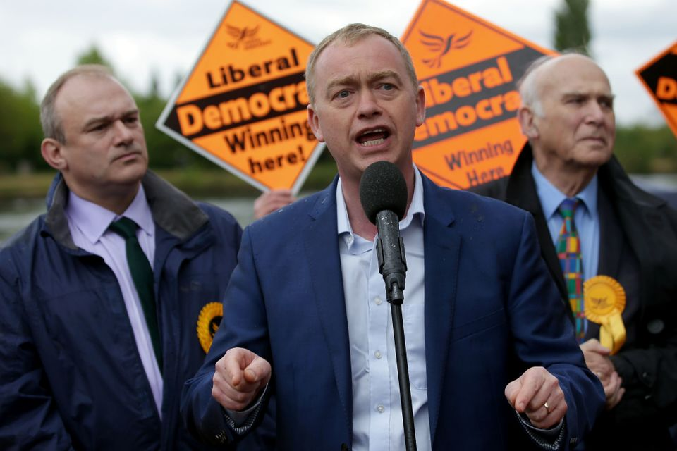 Lib Dem leader Tim Farron (C) speaks alongside former Lib Dem MPs Ed Davey (R) and Vince