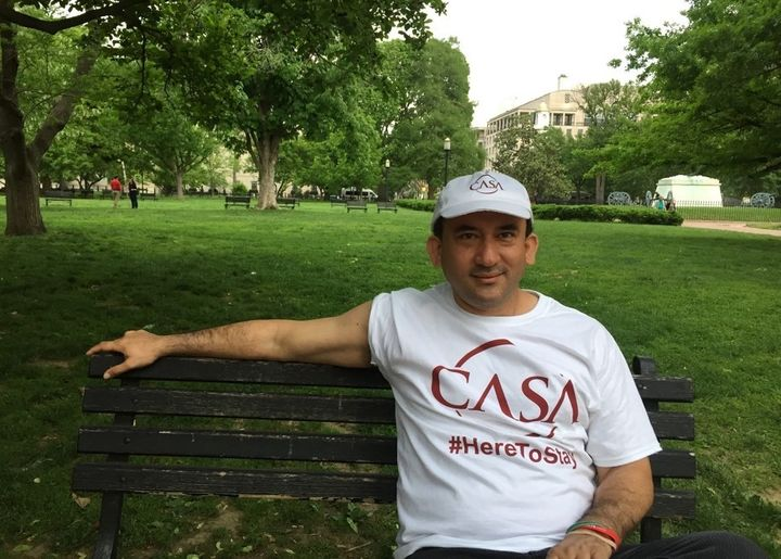 <em>Javier Luna, CASA community organizer, sits on a park bench outside The White House after May Day march protests. Photo b