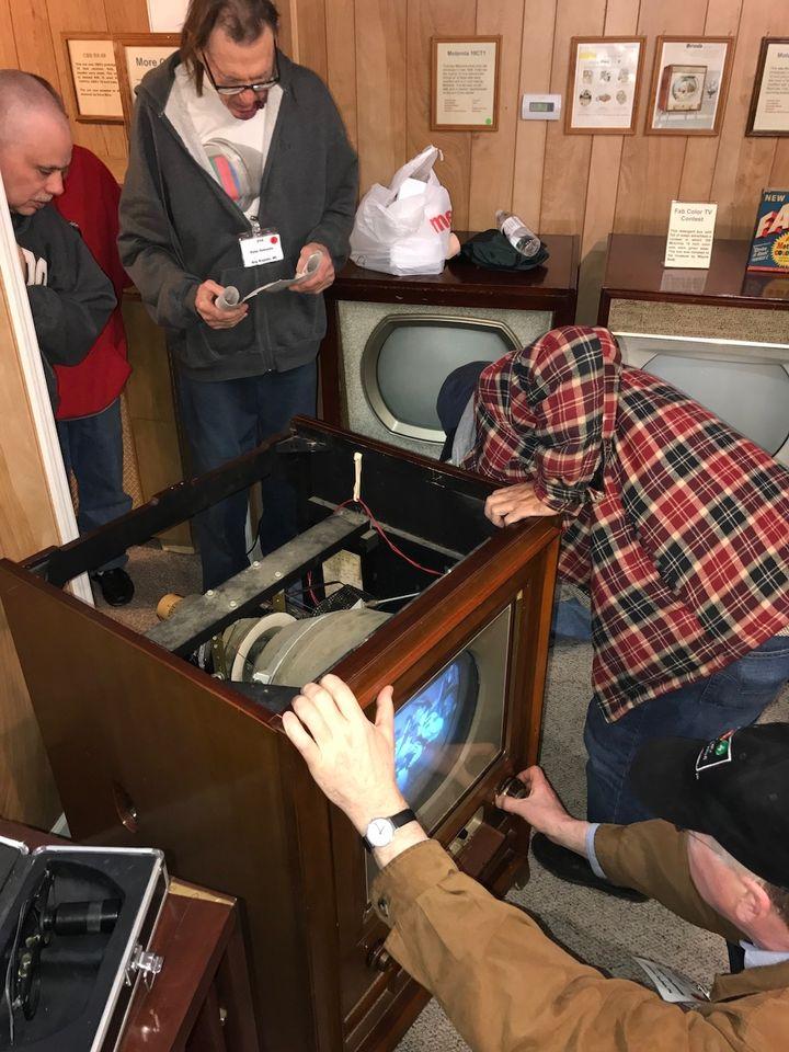 <p>Early TV Museum members repairing a 1954 RCA color TV </p>