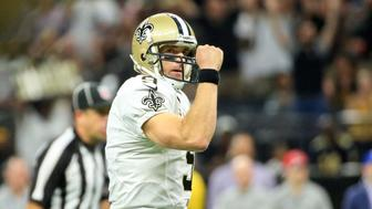 Sep 26, 2016; New Orleans, LA, USA; New Orleans Saints quarterback Drew Brees (9) celebrates after a touchdown pass against the Atlanta Falcons during the first half of a game at the Mercedes-Benz Superdome. Mandatory Credit: Derick E. Hingle-USA TODAY Sports