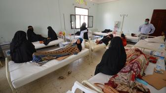 Women sit with relatives infected with cholera at a hospital in the Red Sea port city of Hodeidah, Yemen May 14, 2017. REUTERS/Abduljabbar Zeyad