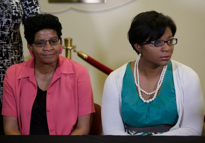 Sandra Bland's mother, Geneva Reed-Veal, left, and sister Sharon Cooper, right, attend a news conference in Lisle, Illinois,