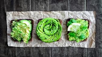 Fresh avocado toasts with alfalfa sprouts & cilantro