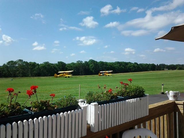 Biplanes take off on the grass airstrip at Van Sant Airport.