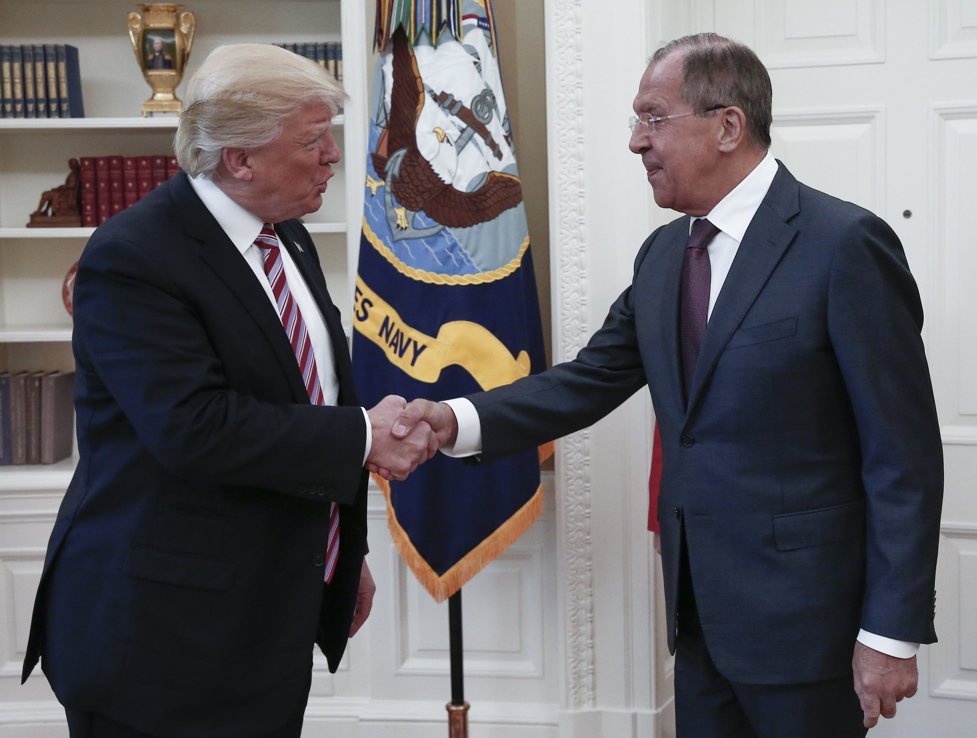 President Donald Trump shakes hands with Russian Foreign Minister Sergei Lavrov as they meet for talks...