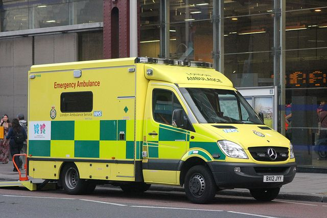 National Health Service (NHS) ambulance outside of Waterloo Station, London.