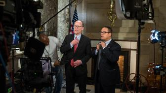 UNITED STATES - FEBRUARY 28: Tom Perez, left, chairman of the Democratic National Committee, and deputy chairman Rep. Keith Ellison, D-Minn., prepare for an interview in Statuary Hall before President Donald Trump addressed a joint session of Congress in the Capitol, February 28, 2017. (Photo By Tom Williams/CQ Roll Call)