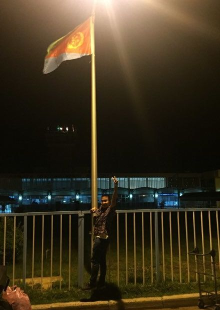 Nguyen hugs country 198's flagpole, clearing customs just after 4:00 am.