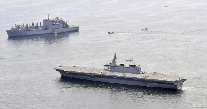 Japan's helicopter carrier Izumo (right) recently escorted a US supply ship along the country's Pacific coast.