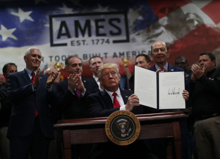 Trump signs an executive order to establish an office of trade and manufacturing policy as part of his campaign to revamp US