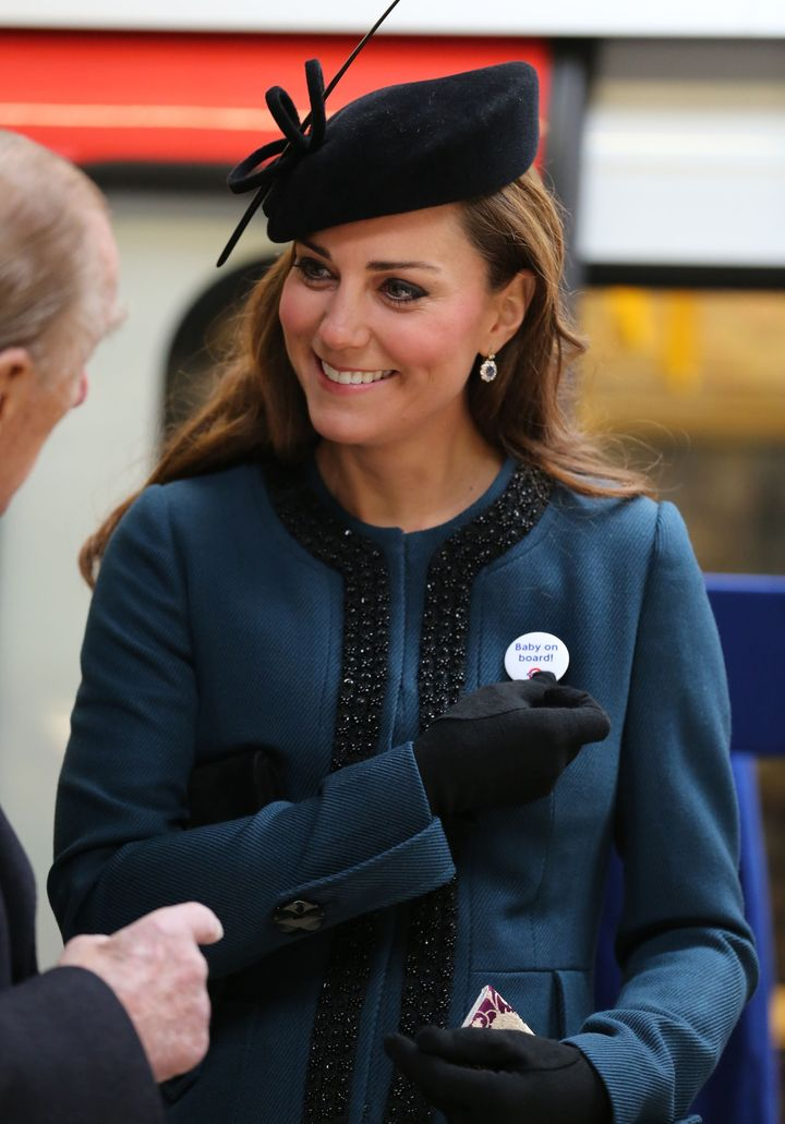 "The Duchess of Cambridge wore a ""Baby on Board"" badge during a Tube station visit to mark the 150th anniversary of the London Underground in 2013."