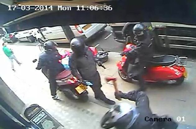 CCTV footage issued by Metropolitan Police of armed robbers who tried to smash their way into Watches...
