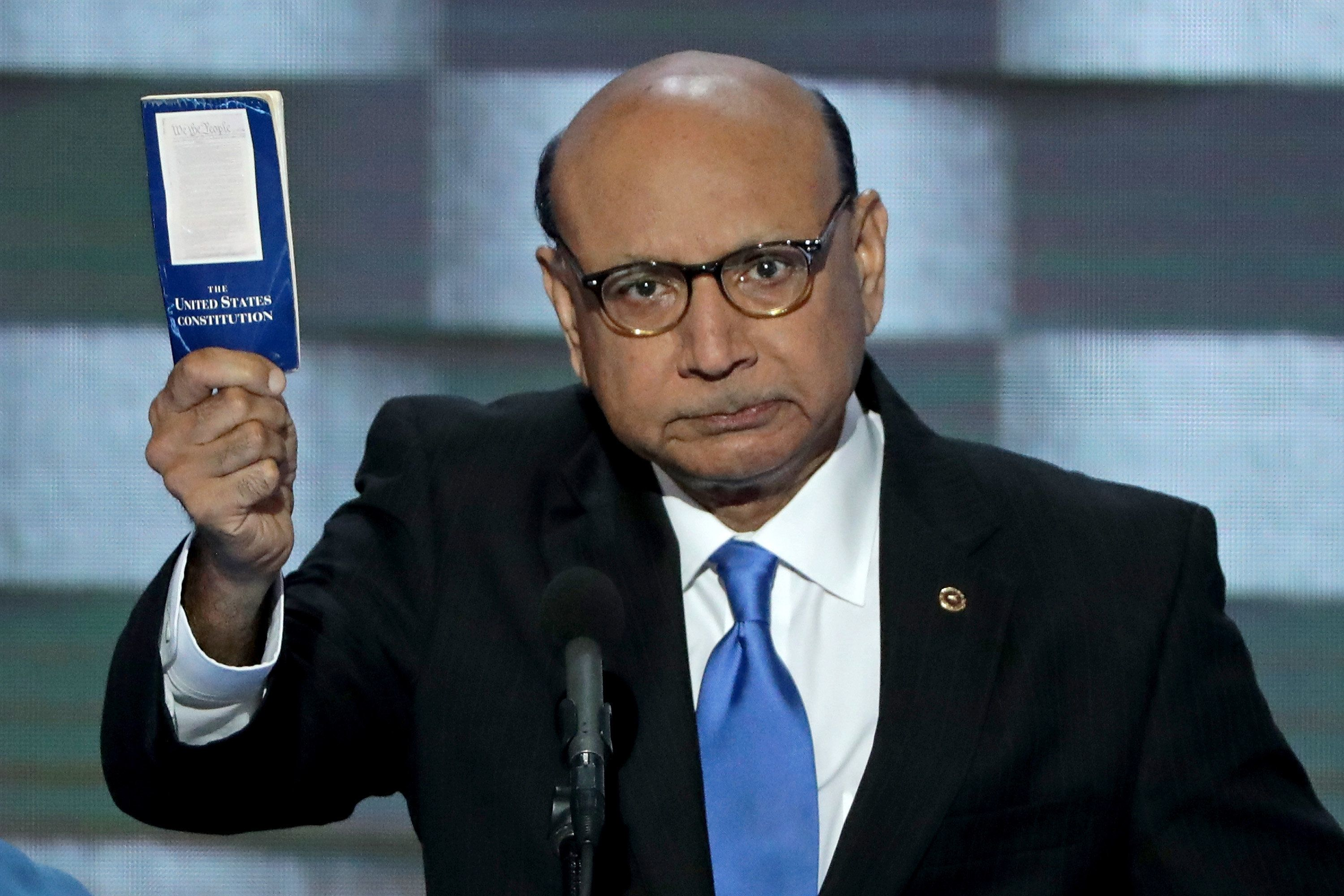 PHILADELPHIA, PA - JULY 28:  Khizr Khan, father of deceased Muslim U.S. Soldier, holds up a booklet of the US Constitution as he delivers remarks on the fourth day of the Democratic National Convention at the Wells Fargo Center, July 28, 2016 in Philadelphia, Pennsylvania. Democratic presidential candidate Hillary Clinton received the number of votes needed to secure the party's nomination. An estimated 50,000 people are expected in Philadelphia, including hundreds of protesters and members of the media. The four-day Democratic National Convention kicked off July 25.  (Photo by Alex Wong/Getty Images)