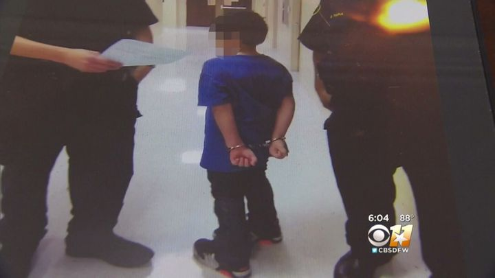 The 7 year olds mother says this photo was taken after police put the boy in handcuffs.