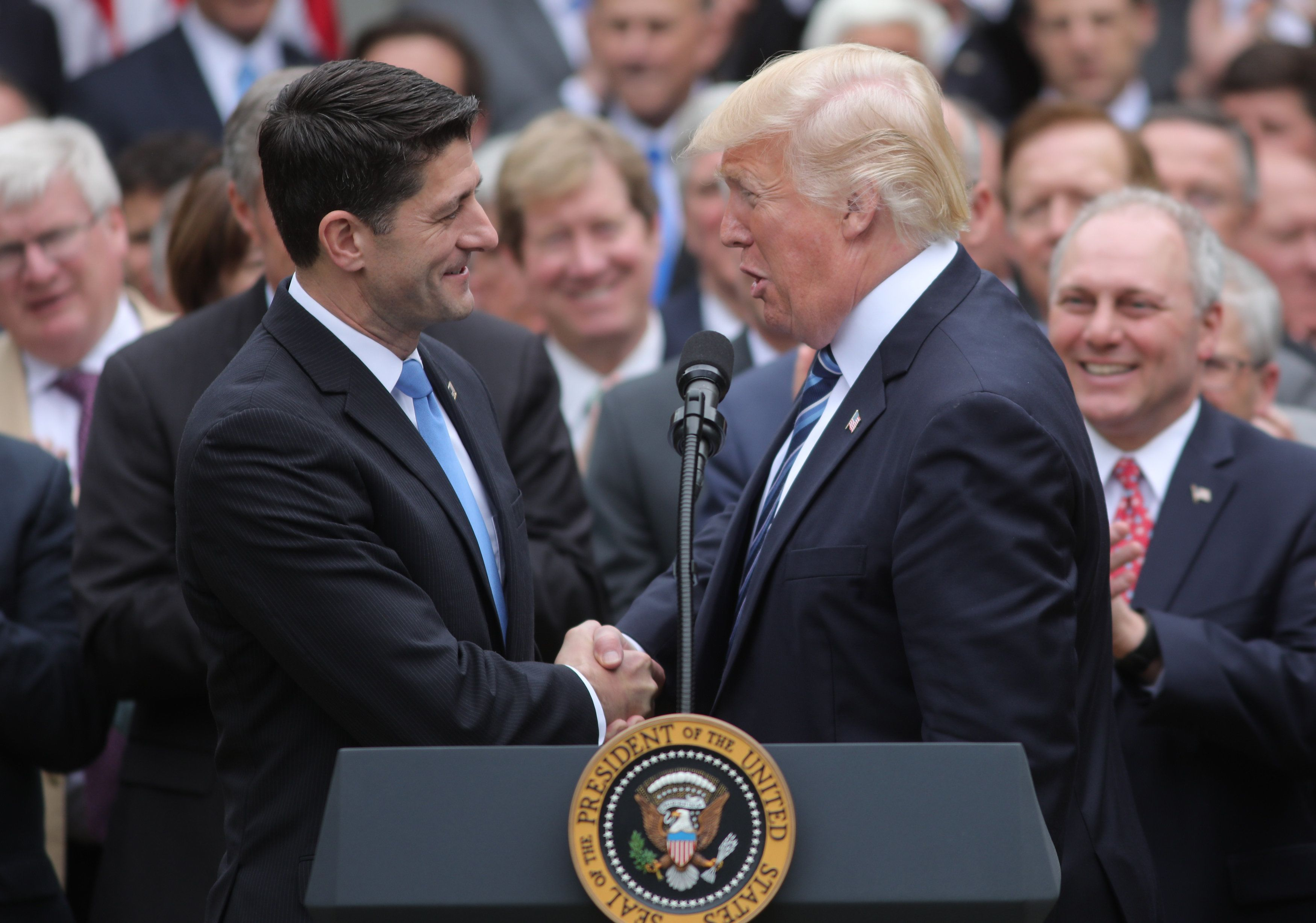 U.S. President Donald Trump congratulates House Speaker Paul Ryan (L) as he gathers with Congressional Republicans in the Rose Garden of the White House after the House of Representatives approved the American Healthcare Act, to repeal major parts of Obamacare and replace it with the Republican healthcare plan, in Washington, U.S., May 4, 2017. REUTERS/Carlos Barria