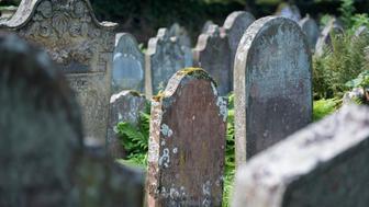 UK, Cumbria, Lanercost, old gravestones on a graveyard