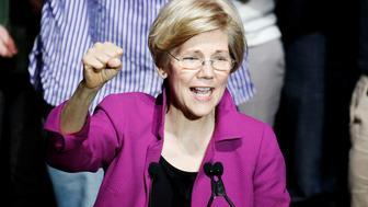 U.S. Senator Elizabeth Warren pumps her fist as she speaks at a Our Revolution rally in Boston, Massachusetts, U.S. March 31, 2017.     REUTERS/Mary Schwalm