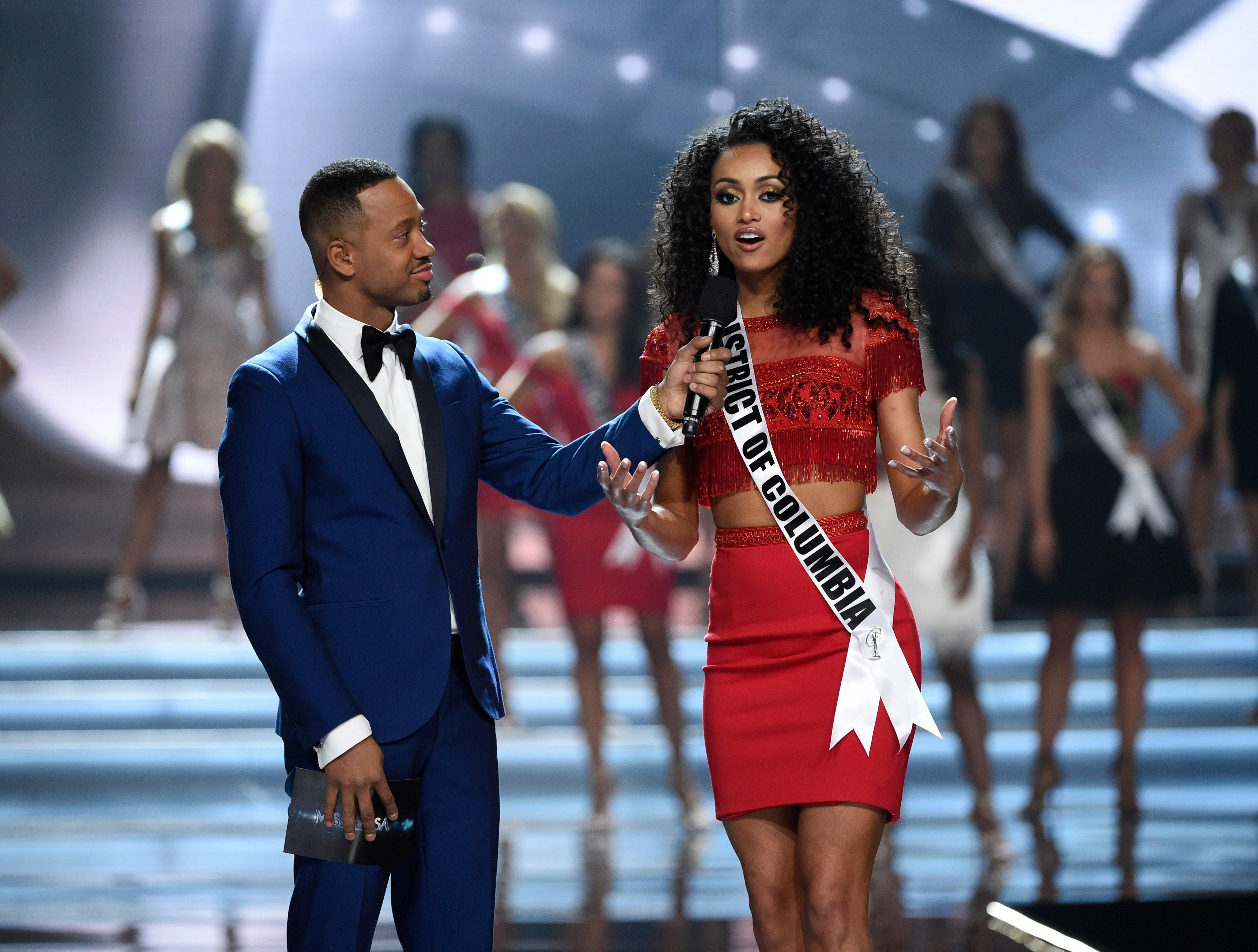 Miss USA co-host Terrence J interviews Miss District of Columbia Kara McCullough, who won but then immediately faced criticis