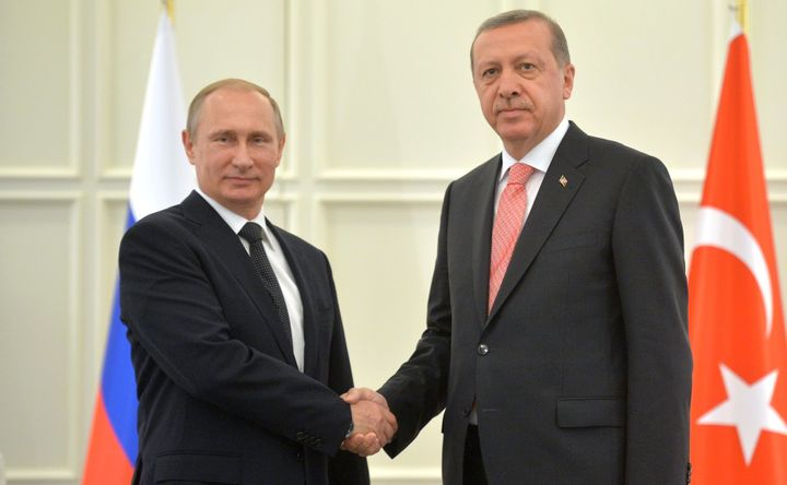 Russian president Vladimir Putin and Erdoğan during a meeting in Baku, 13 June 2015 .