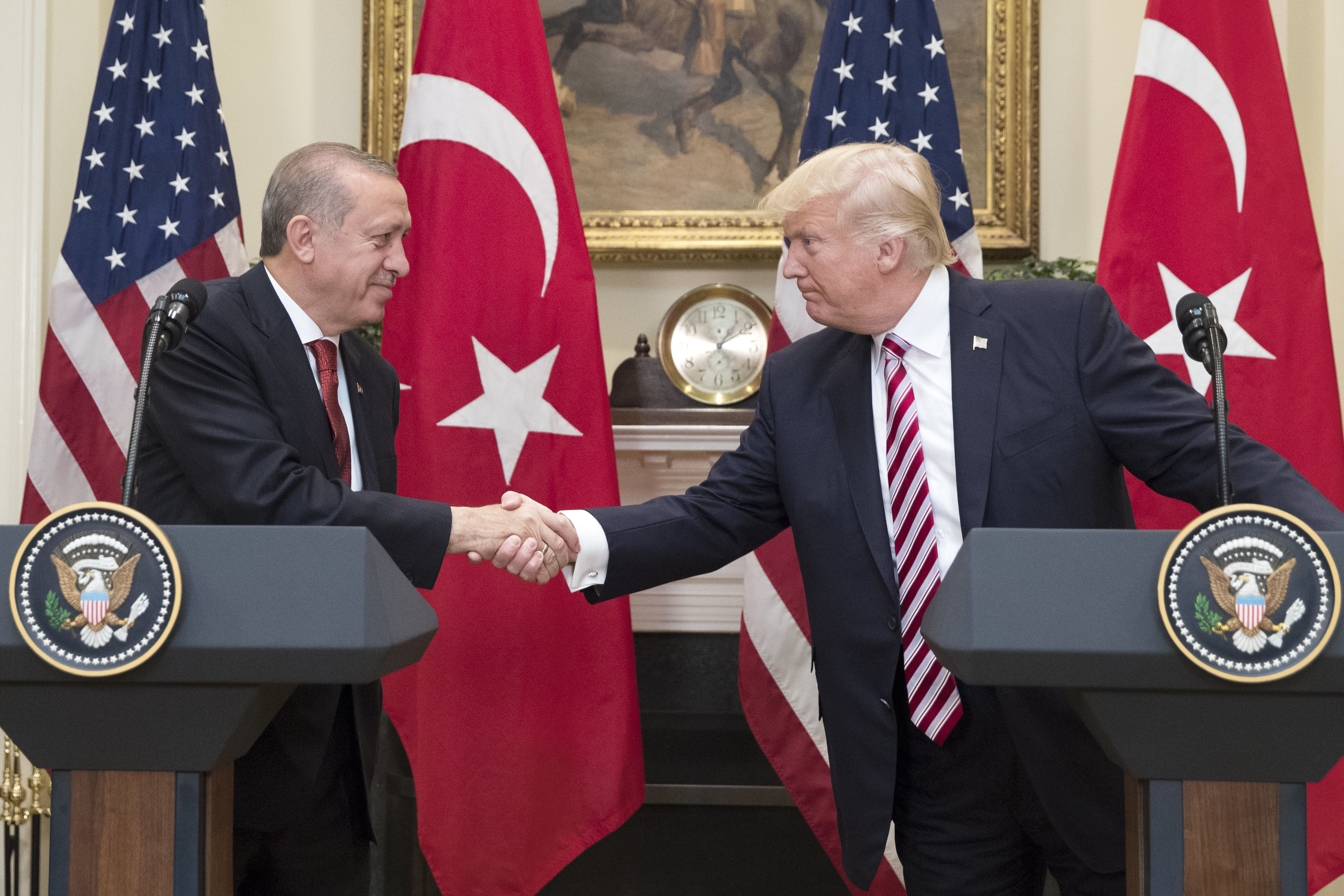 U.S. President Donald Trump, right, shakes hands with Recep Tayyip Erdogan, Turkey's president, during a news conference at the Roosevelt Room of the White House in Washington, D.C., U.S., on Tuesday, May 16, 2017. Erdogan said he's looking forward to a 'decisive meeting' with his U.S. counterpart Trump, whose decision to arm Kurdish groups against Islamic State in Syria has stoked tensions between the two NATO members. Photographer: Michael Reynolds/Pool via Bloomberg
