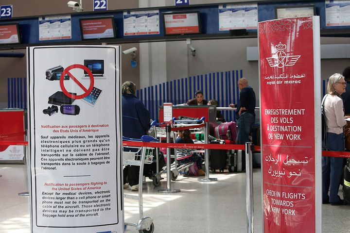 <p> Placards at Casablanca Mohammed V International Airport inform passengers that laptops and other electronic devices must be checked on flights to the U.S. and the U.K.</p>