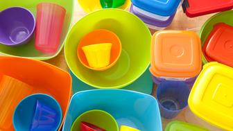 Top view of lots of plastic kitchen utensils, mostly containers