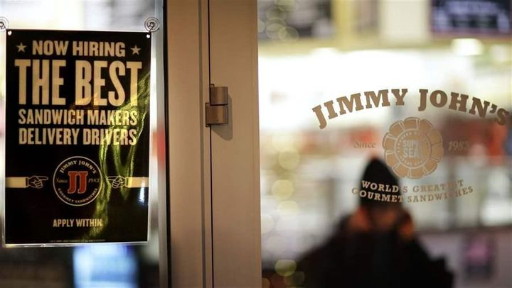 A sign advertising hiring opportunities at a Jimmy John's sandwich shop. Jimmy John's agreed to stop asking low-wage workers