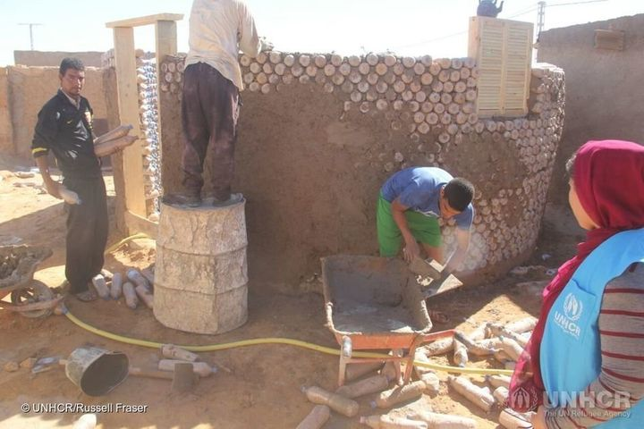 Workers construct one of the new houses.