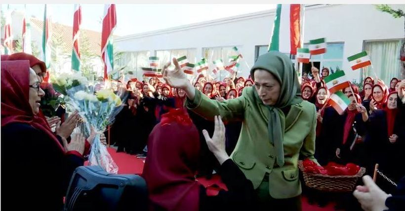 Maryam Rajavi and her flag waving slaves in Tirana, Albania