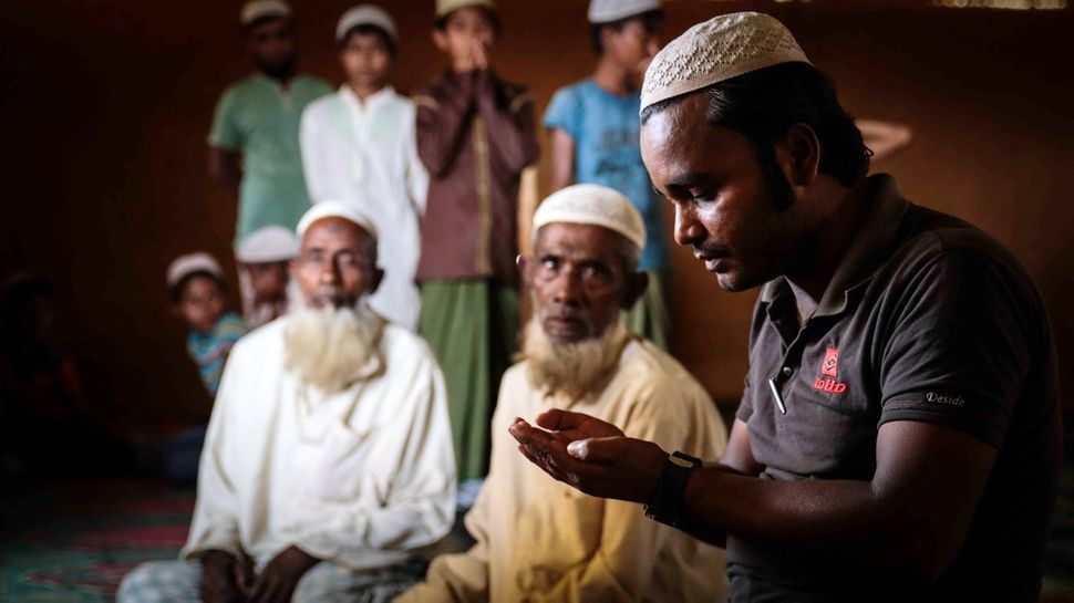 Nur Kabir takes a break from his work as a doctor to pray. The Rohingya are a Muslim ethnic minority group in Myanmar, which