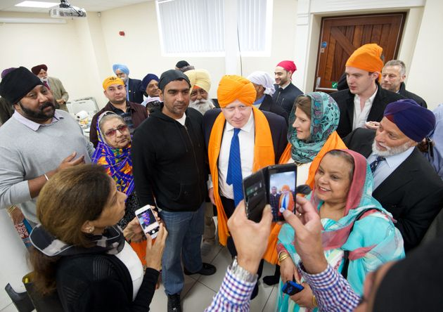 Johnson wore an orange turban during his visit to the temple in Bristol on