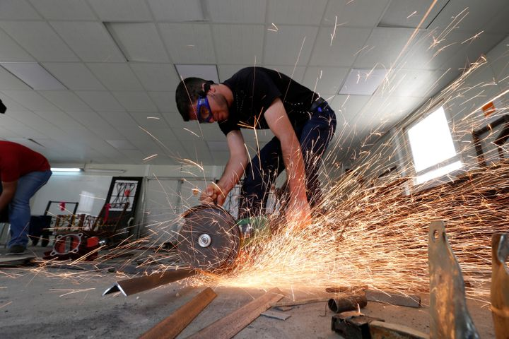 Syrian refugee metal shop trainees work at one of the vocational training centers in the Azraq camp,June 27, 2016.