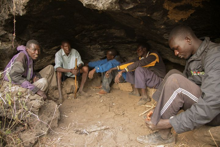 Friends gather in a cave in Kenya's Great Rift Valley. People who live here are at greater risk of contracting cutaneous leis