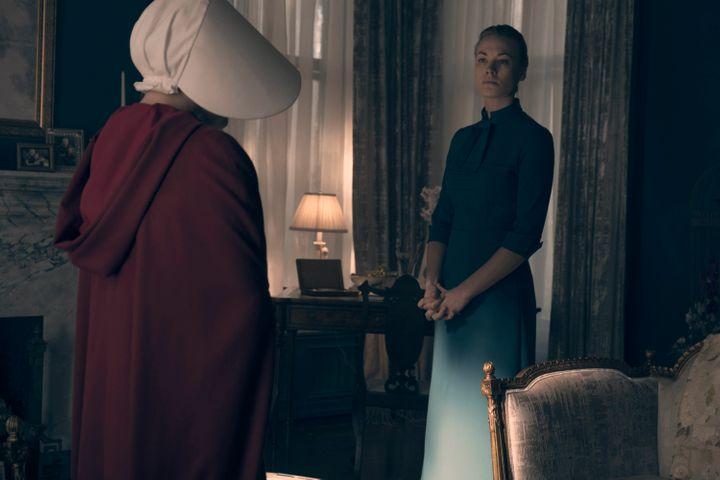 "Yvonne Strahovski and Elisabeth Moss in ""The Handmaid's Tale."""