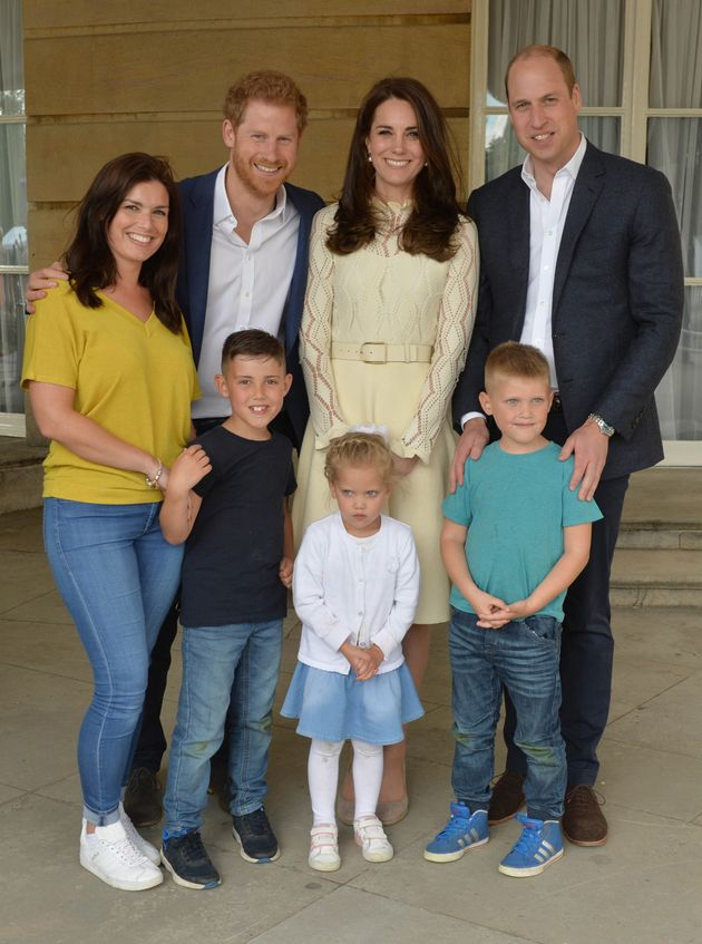 Prince Harry, Catherine, Duchess of Cambridge and Prince William stand backstage with Samantha Davidson...