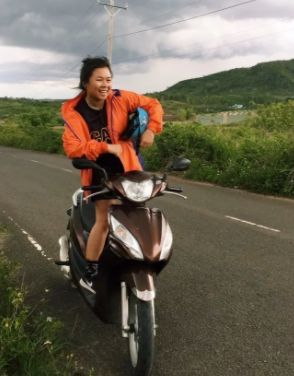 Tran riding her sweet moped.