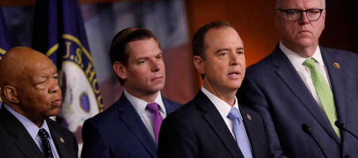 Democratic House members Adam Schiff of California, second from right, accompanied by Elijah Cummings of Maryland, left, Eric