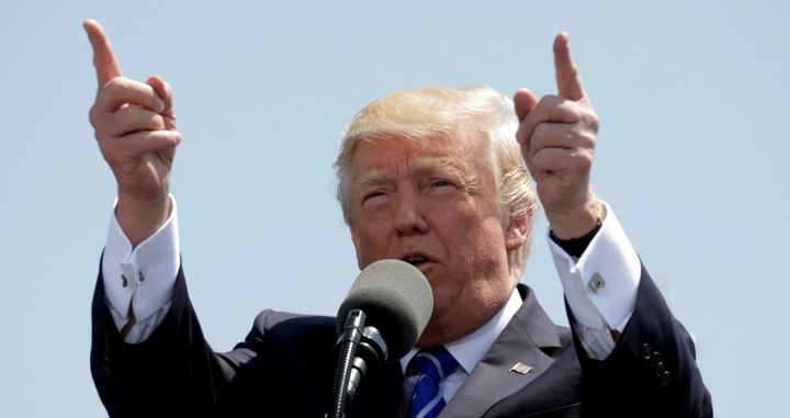 President Donald Trump speaks during the United States Coast Guard Academy Commencement Ceremony in New London, Connecticut U