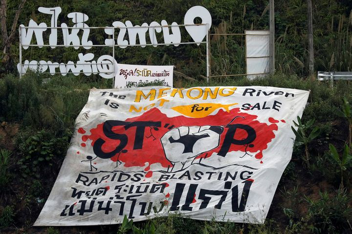 A protest banner against rapids blasting in the Mekong River at the border between Laos and Thailand.