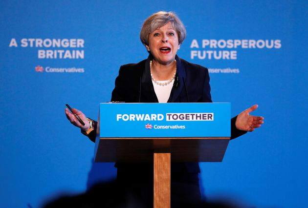 Theresa May has annnounced Tory plans tostop people from voting if they don't own a passport...