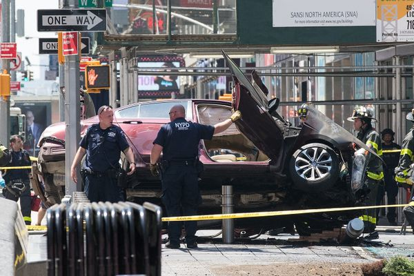 A wrecked car sits in the intersection of 45th and Broadway in Times Square, May 18, 2017, in New York City.