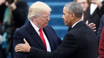 President Barack Obama (R) greets President elect Donald Trump at inauguration ceremonies swearing in Donald Trump as the 45th president of the United States on the West front of the U.S. Capitol in Washington, U.S., January 20, 2017. REUTERS/Carlos Barria