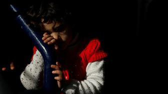 A child migrant waits to disembark from the Malta-based NGO Migrant Offshore Aid Station (MOAS) ship Phoenix after it arrived with migrants and a corpse on board, in Catania on the island of Sicily, Italy, May 6, 2017.    REUTERS/Darrin Zammit Lupi