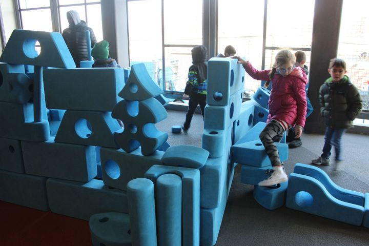 BASIS elementary students play with blocks in a half-indoor, half-outdoor recreation room. BASIS gives its K-3 kids three 15-