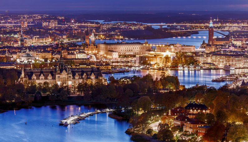 Stockholm by night with the Nordic Museum, lower left, and the Royal Palace, center.