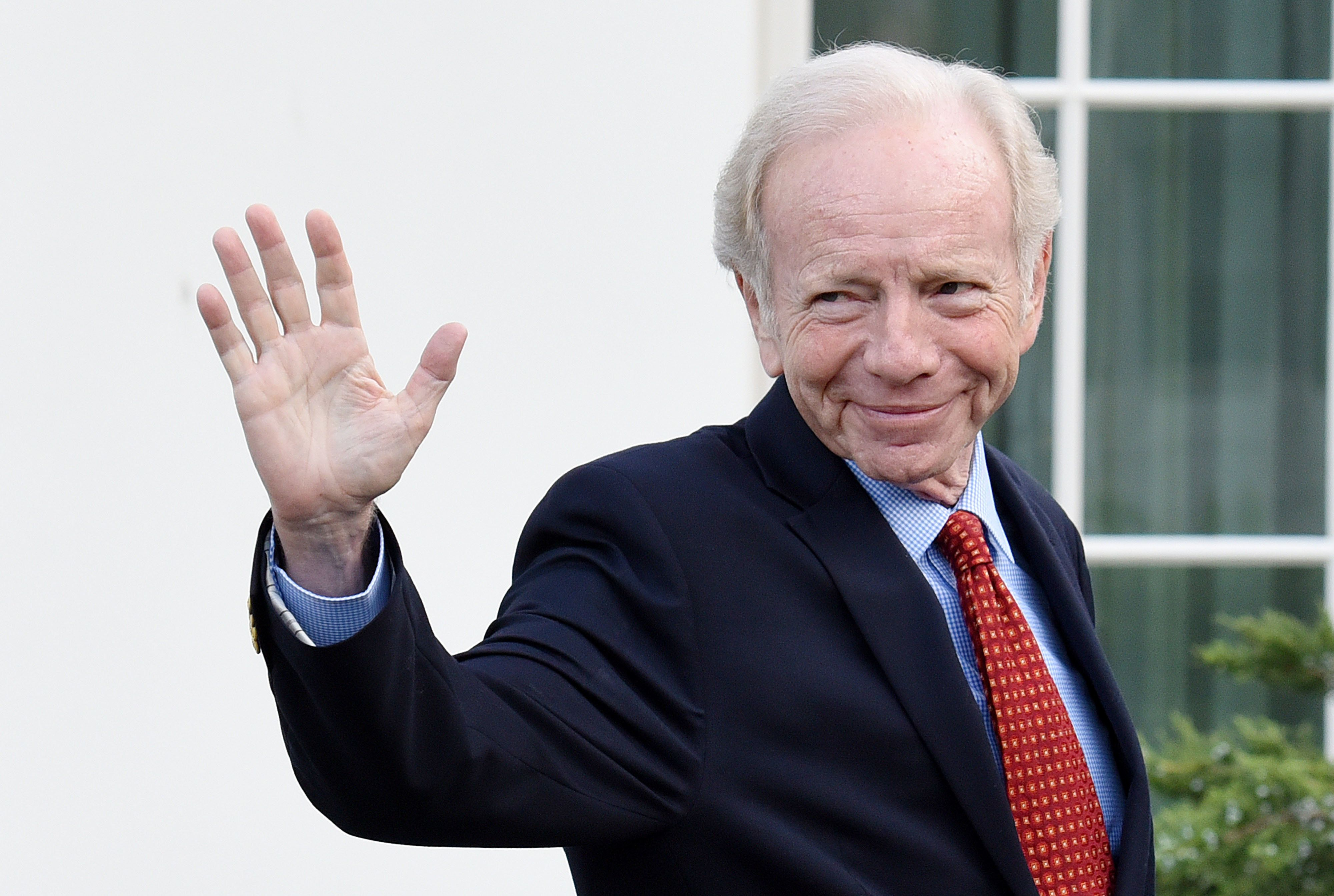 Former Sen.Joe Lieberman leaves the West Wing of the White House after meeting with President Donald Trump onWedn
