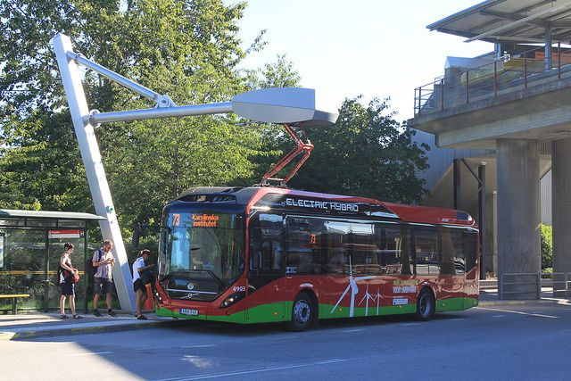 New hybrid-electric city bus at a Stockholm charging station. Buses charge within 6 minutes and can travel up to 7 kilometers