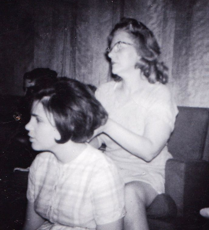 Viola Liuzzo brushing daughter Mary's hair just before she went to Selma, Alabama to help African Americans register to